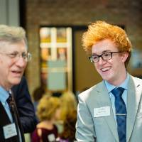 Student laughing with a donor at Scholarship Dinner 2019